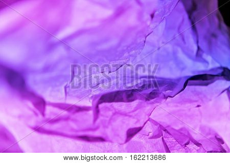 Abstract wrinkled paper texture with colorful background