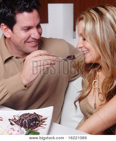 Young couple enjoying a sweet moment in a restaurant,