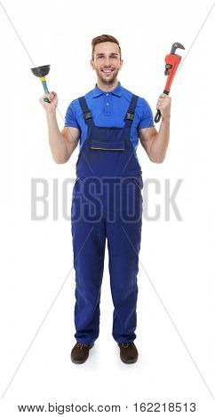 Plumber in blue uniform holding screw-wrench and plunger on white background