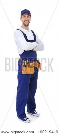 Plumber with tool belt and crossed hands isolated on white