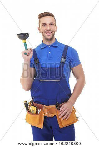 Plumber in blue uniform holding plunger on white background