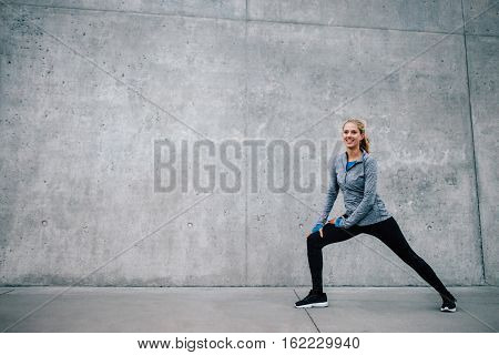 Female Runner Stretching After Running Session