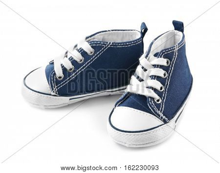 Pair of baby sneakers on white background