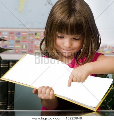 Young child pointing to a page in a book