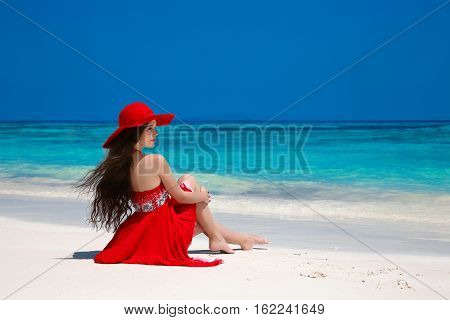 Beautiful Carefree Woman In Hat Enjoying Exotic Sea, Brunette Relax On Tropical Beach At Summer Holi