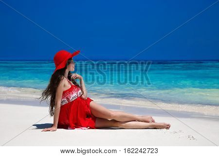 Healthy Lifestyle. Beautiful Carefree Woman In Hat Enjoying Exotic Sea, Brunette Lying On Tropical B