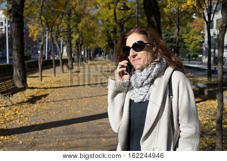 Smiling Woman At Phone In Autumn City