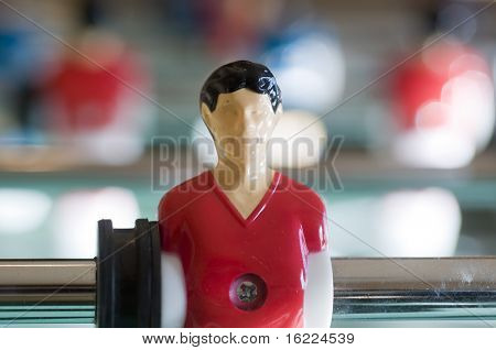 Football player in Foosball bar football game