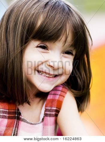Portrait of an adorable young girl  with funny excited look on her face