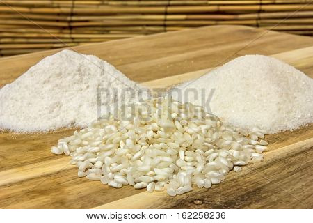 Piles of riceflour and semolina on a wooden table. Close