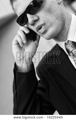 Undercover Federal agent receiving information on cell phone.