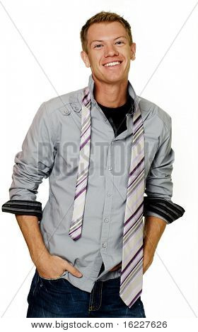 Happy friendly positive young man a hard days work with tie hanging from shirt ready to have fun or relax.