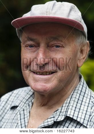 Happy content relaxed senior man outside