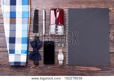 Paper notepad and accessories. Shirt, watch and pen. Success consists of many details.