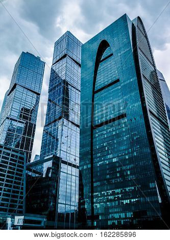 oscow, Russia - September 24, 2016: Awesome modern glass skyscrapers in the Business centerBlue skyscraper facade. office buildings. modern glass silhouettes of skyscrapers