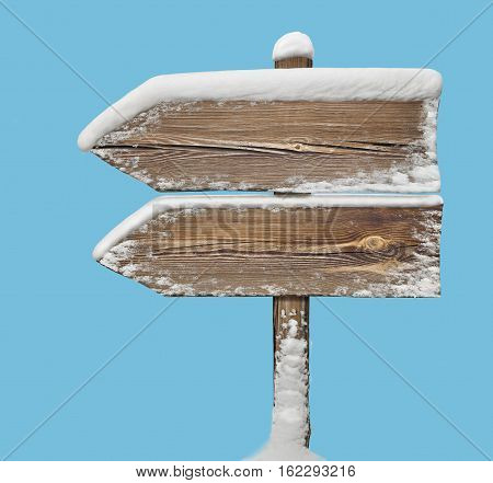 Wooden Direction Sign With Snow On Blue. Two_arrows-one_direction