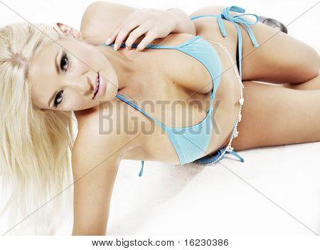 Sexy beautiful blond woman wearing blue bikini