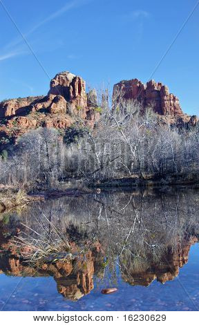Sedona,AZ,USA,Cresent Moon Rock.  Creek with reflection of red mountain.