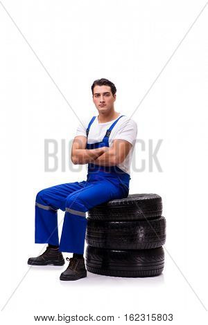 Handsome tyre repairman isolated on white