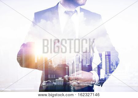 Businessperson on city background. Double exposure. Close up.