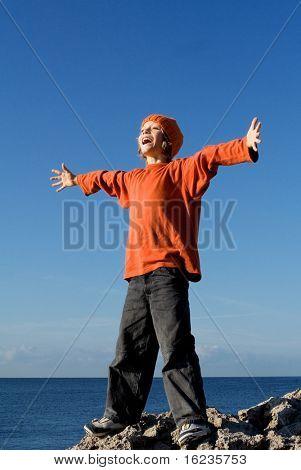 happy smiling boy praising the skies