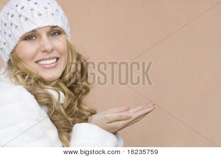 winter woman with empty hands waiting for your product.(maybe a valentines,birthday or christmas present)