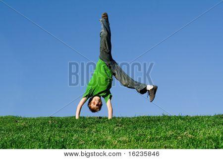 happy boy doing a cartwheel