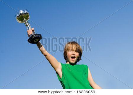 happy boy with winning trophy