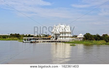 BANGKOK, THAILAND - November 4, 2016: Display of different living styles with a wealthy mansion on the banks of the Chao Phraya River in Bangkok Thailand