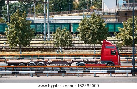 truck on road, industrial infrastructure and railroad in sea port, cargo transportation, delivery and shipping concept