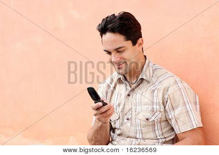 Man and cell or mobile phone