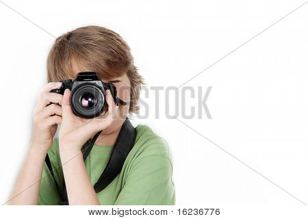 child or teen boy with slr camera