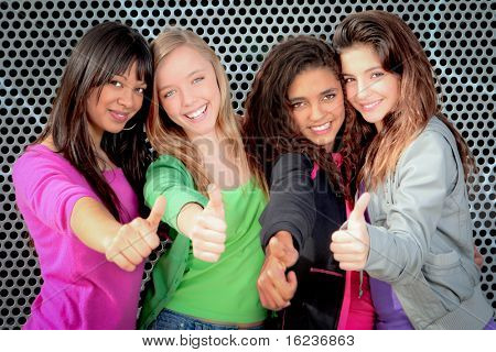 Happy diverse group of teenage girls showing thumbs up