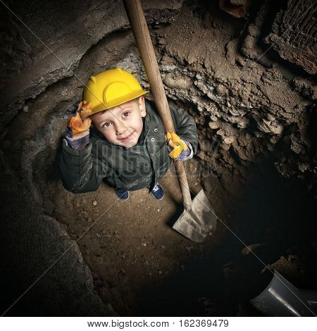 little handyman at work in construction site