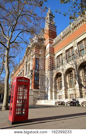 LONDON, UK - NOVEMBER 28, 2016: The external facade of Victoria and Albert Museum in South Kensington with a telephone red box in the foreground