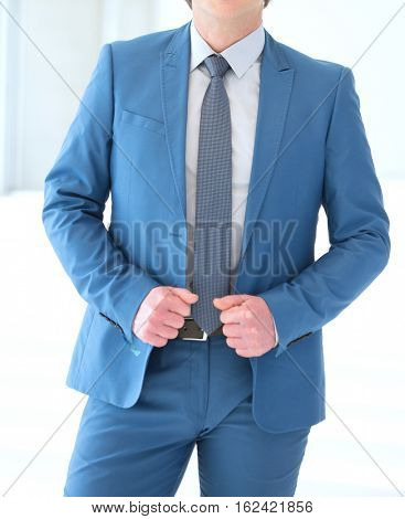 Portrait of confident mature businessman standing in new office