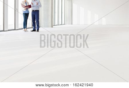 Distant image of business people discussing in empty office