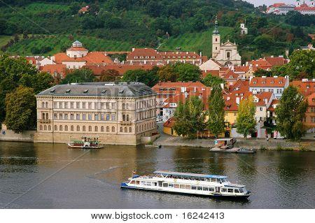 The Red Roofs On Vltava's Riverside In Prague