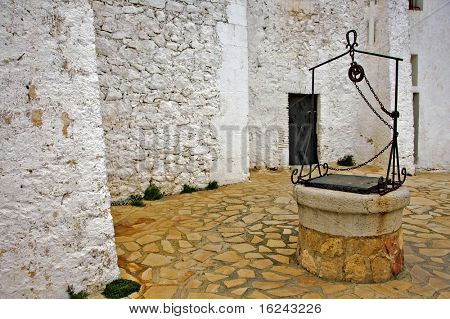 view of a courtyard with an old water well