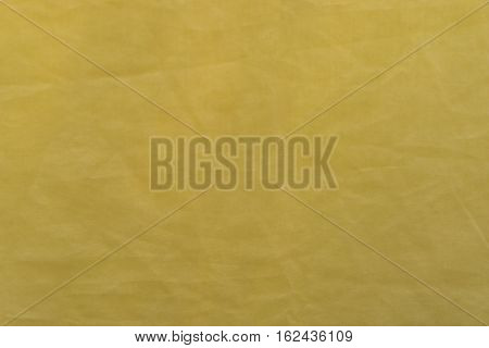 wrinkled yellow fabric surface texture and background.