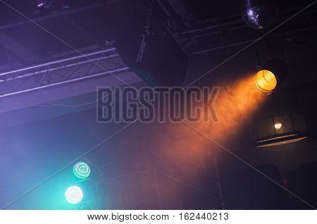 Spot Lights Over Dark Ceiling Background