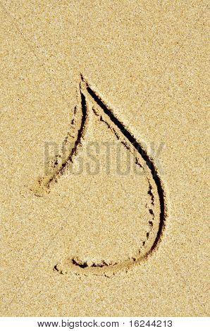 s letter written in the sand on a beach