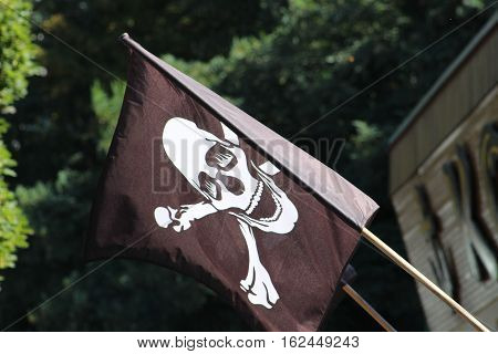 Jolly Roger Pirate Flag/This is a pirate flag flying in wind.