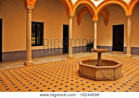 view of a patio in Alcazar of Seville, in Spain