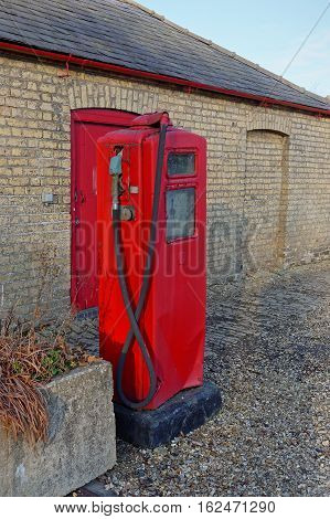 An olddisused petrol or gasoline pump in the UK countryside