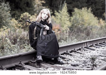 Muslim Woman With Arms On The Rails