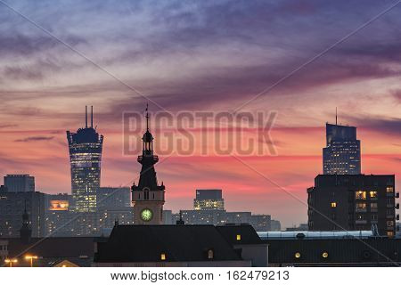 Dramatic sundown over Warsaw city during winter time