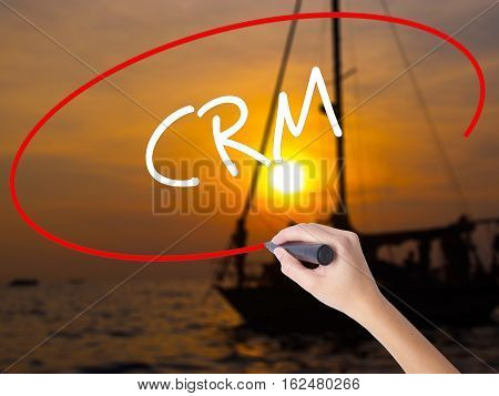 Woman Hand Writing Crm With A Marker Over Transparent Board