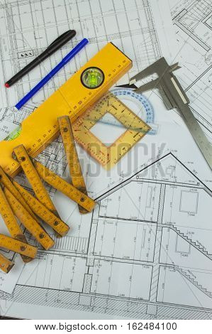 Desk project supervisor. Plans of building. Architectural project. Floor plan designed building on the drawing.