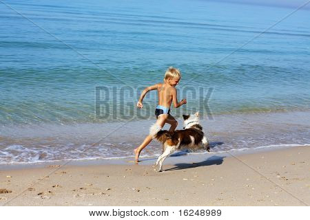 boy playing dog